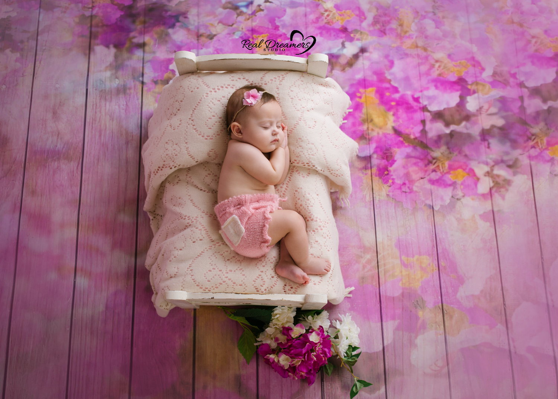 Servizio-Fotografico-Bebè- lettino-fiori
